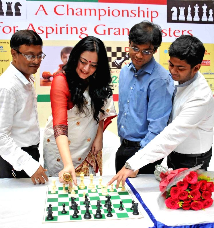 "Fashion designer Agnimitra Paul during the inauguration of ""Chess For Youth"" in Kolkata on May 6, 2017. Also seen Chess grandmasters Dibyendu Barua, Neelotpal Das and Diptayan ... - Diptayan Ghosh"