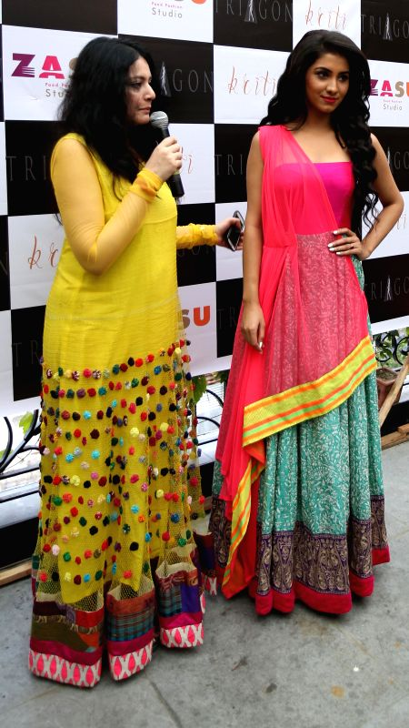 Fashion designer Agnimitra Paul with a model during inauguration of `Kriti` in Kolkata on Aug 21, 2014.