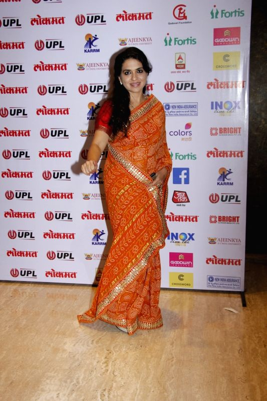 Fashion designer and BJP leader Shaina NC arrives to attend the 4th edition Lokmat Maharashtrian of The Year 2017 in Mumbai on April 11, 2017.