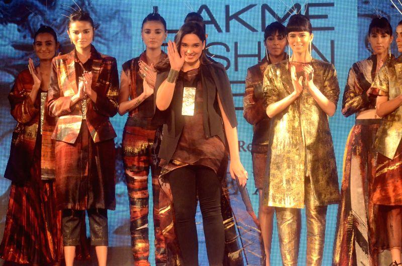 Fashion designer Helena Bajaj Larsen with her models during the Lakme Fashion Week Summer/Resort 2018 in Mumbai on Jan 31, 2018.