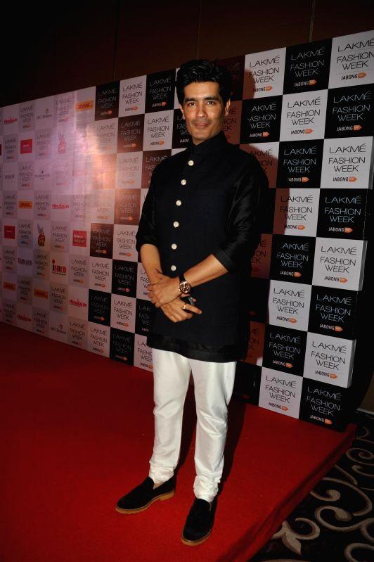 Fashion designer Manish Malhotra during Lakme Fashion Week curtain-raiser in Mumbai on July 28, 2014. - Manish Malhotra