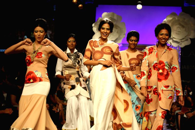 Fashion designer Masaba Gupta walk with Bollywood actor Shilpa Shetty during her show at the Lakme Fashion Week (LFW) Winter/ Festive 2014 in Mumbai, on Aug. 20, 2014. - Shilpa Shetty