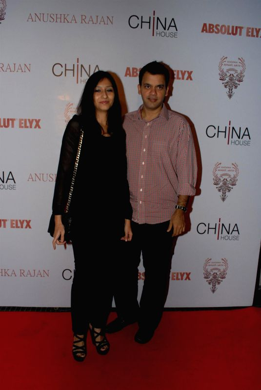 Fashion designer Nachiket Barve along with his wife Surabhi during the Absolut Elix and Anushka Ranjan fashion preview in Mumbai, on July 31, 2014.