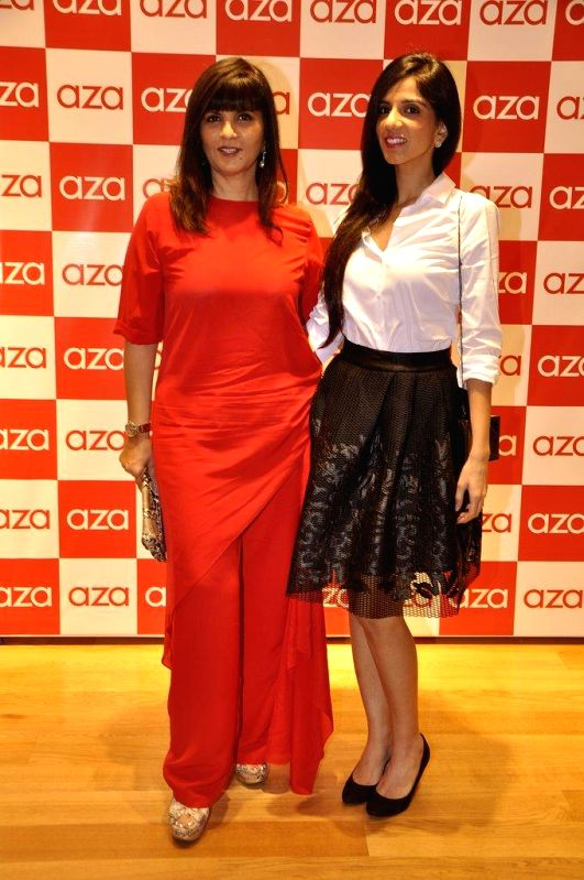 Fashion designer Neeta Lulla with her daughter Nishka Lulla during the launch of Aza store in Mumbai, on Aug 28, 2014.