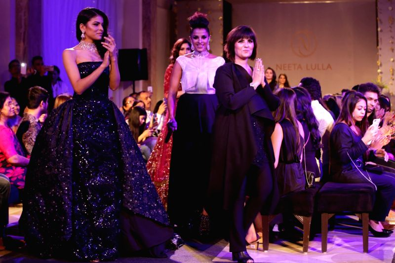 Fashion designer Neeta Lulla with models showcasing her creations at India Couture Week 2018 in New Delhi, on Aug 3, 2018.