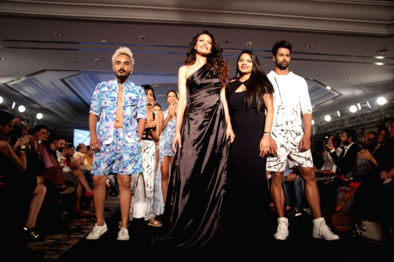 Fashion designer Nidhi Munim and actress Dipannita Sharma during her show at the India Intimate Fashion Week in Mumbai on March 18, 2017. - Dipannita Sharma