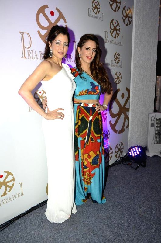 Fashion designer Pria Kataaria Puri with Bollywood actor Aditi Gowitrikar during the launch of her store in Mumbai, on Aug 28, 2014. - Aditi Gowitrikar