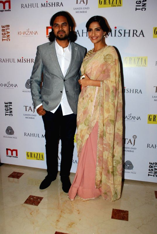 Fashion designer Rahul Mishra and Actor Sonam Kapoor during the designer Rahul Mishra`s bash at Taj Lands End, in Mumbai, on Thursday as he celebrated six years in fashion industry with Grazia. - Sonam Kapoor