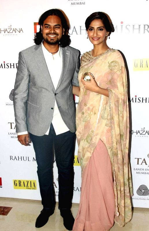 Fashion designer Rahul Mishraand and Actor Sonam Kapoor during the designer Rahul Mishra`s bash at Taj Lands End, in Mumbai, on Thursday as he celebrated six years in fashion industry with Grazia. - Sonam Kapoor
