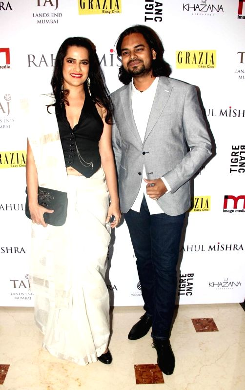 Fashion designer Rahul Mishraand and Singer Sona Mohapatra during the designer Rahul Mishra`s bash at Taj Lands End, in Mumbai, on Thursday as he celebrated six years in fashion industry with Grazia.
