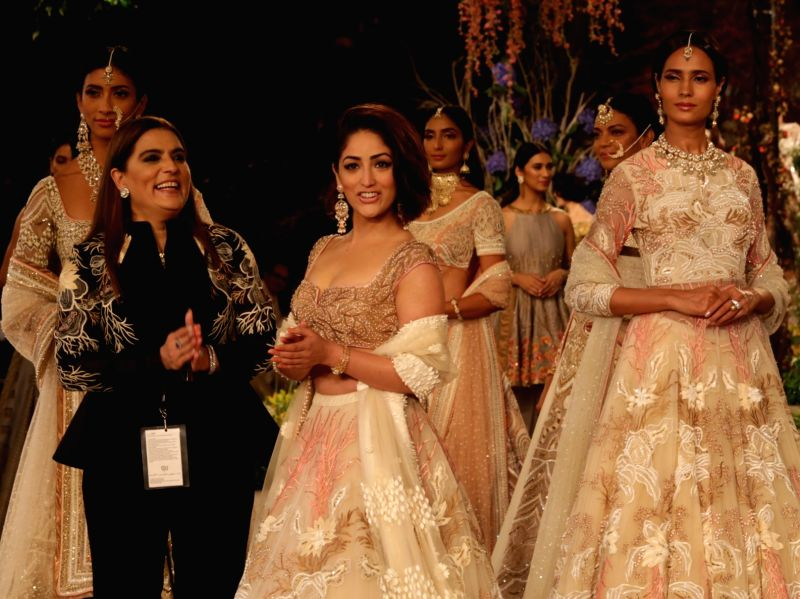 Fashion Designer Reynu Taandon with models showcasing her creations at India Couture Week 2018 in New Delhi, on July 29, 2018.