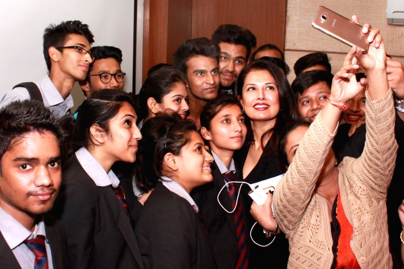 "Fashion Designer  Ritu Beri  takes a selfie -self portrait-  during an interactive session '""Luxury is Excellence'"" organised by AIMA in New Delhi, on Dec 8, 2015."