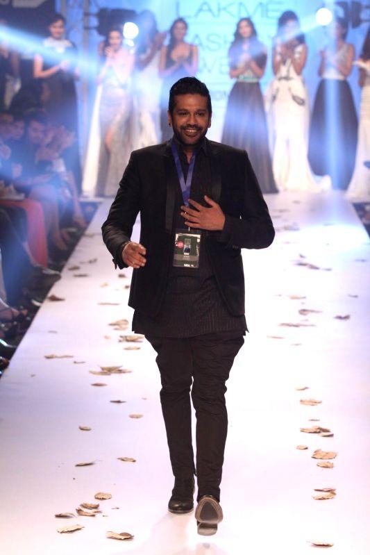 Fashion designer Rocky S during the Lakme Fashion Week (LFW) Winter/ Festive 2014, in Mumbai, on Aug. 21, 2014.