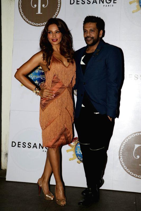 Fashion designer Rocky S with actress Bipasha Basu during 24K Gold Party in Mumbai, on Aug 13, 2015. - Bipasha Basu