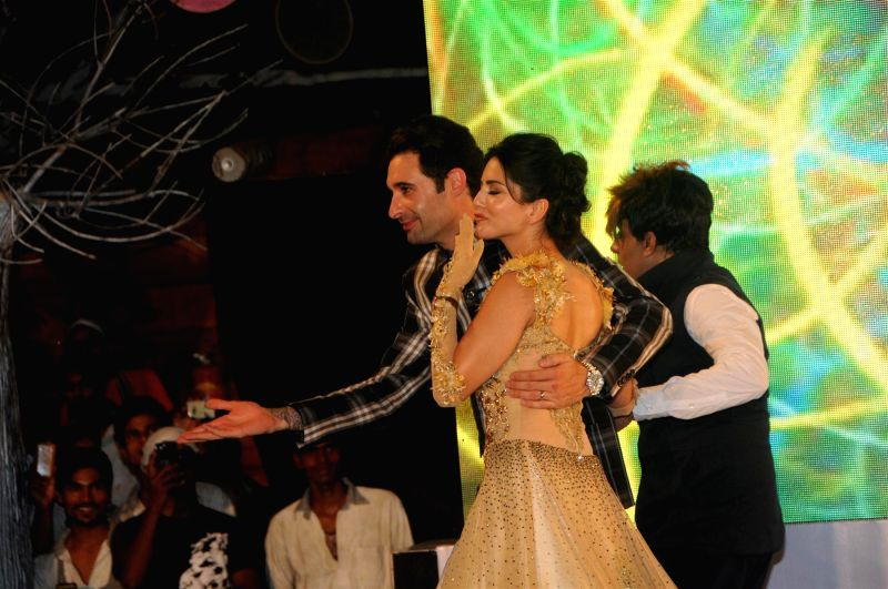 Fashion designer Rohit Verma actor Sunny Leone her husband Daniel Weber during the fashion show organised to show case Rohit Verma latest collection in association with Aabhasa Watches in Mumbai on .. - Sunny Leone