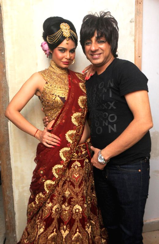 Fashion designer Rohit Verma and actor Kavitta Verma during the preview his newest collection `Vrindavan` presented this Janmashtami, in Mumbai on Aug 14, 2014. - Kavitta Verma