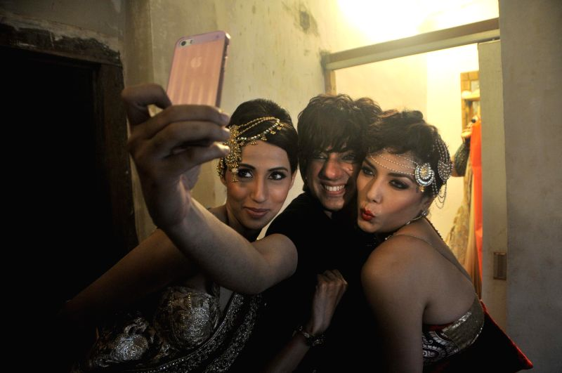 Fashion designer Rohit Verma and Models Alesia Raut and Diandra Soares during the preview his newest collection `Vrindavan` presented this Janmashtami, in Mumbai on Aug 14, 2014.