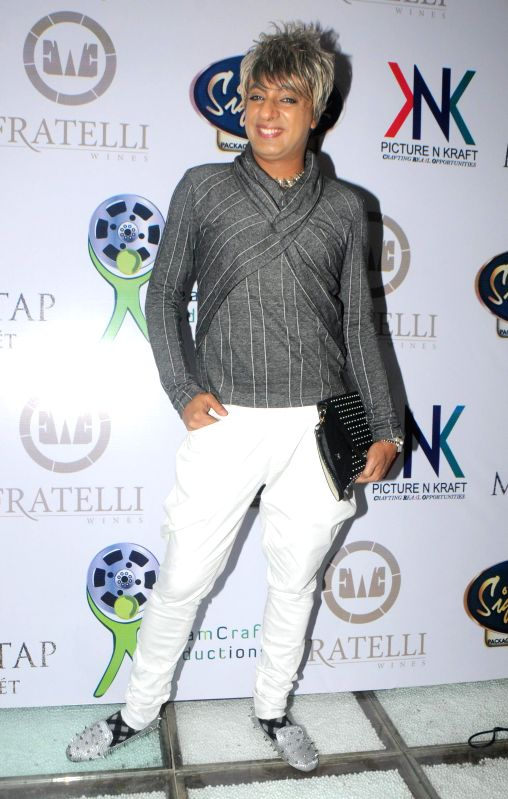 Fashion designer Rohit Verma during the launch of Manali Jagtap's new `Clutch Closet` bridal handbag collection preview event in Mumbai on July 11, 2014. - Rohit Verma