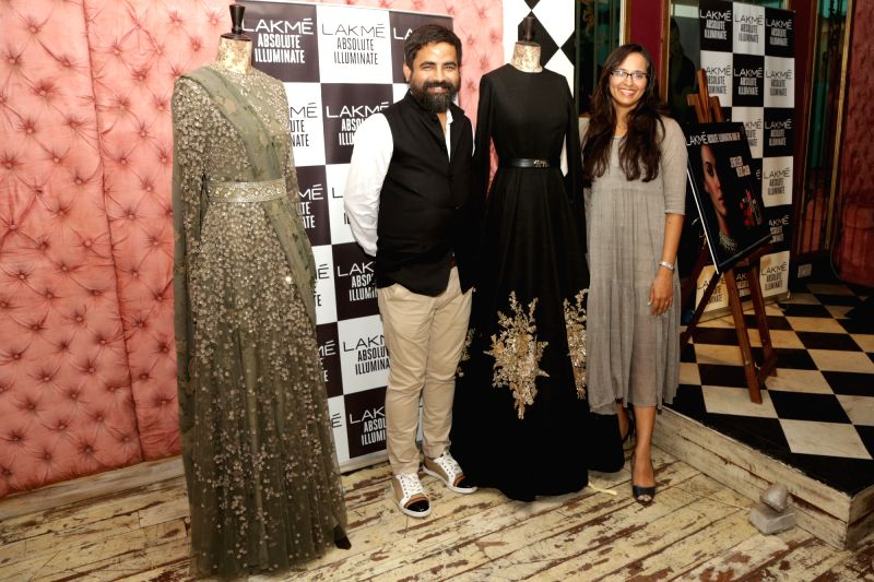 Fashion Designer Sabyasachi Mukherjee with Lakme's innovation head Purnima Lamba at the preview of Sabyasachi's Lakme Fashion week Grand Finale collection, in New Delhi on Aug 8,2016. - Designer Sabyasachi Mukherjee