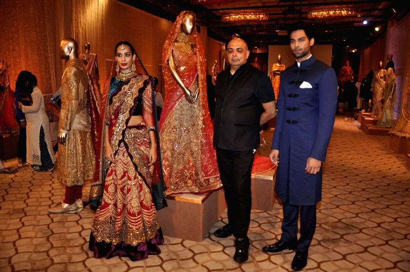 Fashion designer Tarun Tahiliani presents The Modern Mughals during the sixth edition of the Bridal Couture Exposition in Mumbai on July 11, 2014.