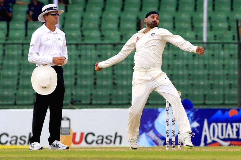 Fatullah (Bangladesh): Indian bowler Harbhajan Singh in action during the last day of the lone test match between India and Bangladesh at Khan Shaheb Osman Ali Stadium in Fatullah, Bangladesh on June ... - Harbhajan Singh