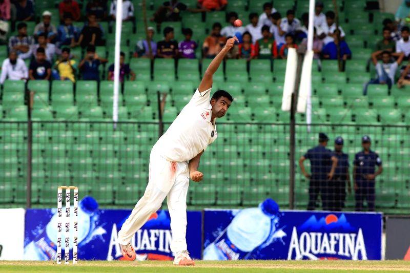 Fatullah (Bangladesh): Indian bowler Ravichandran Ashwin in action during the last day of the lone test match between India and Bangladesh at Khan Shaheb Osman Ali Stadium in Fatullah, Bangladesh on ... - Ravichandran Ashwin