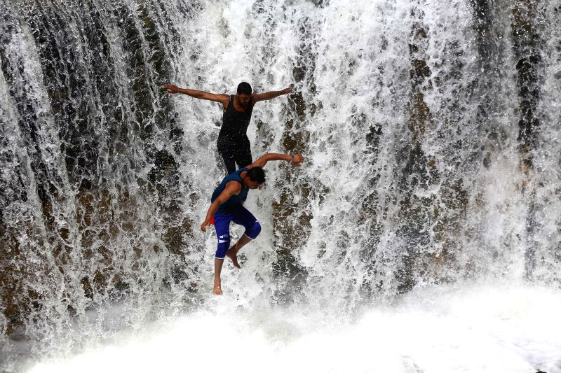 FAYOUM, May 12, 2016 - People jump into the water at a waterfall in Wadi El-Rayan of Fayoum, Egypt, on May 10, 2016.