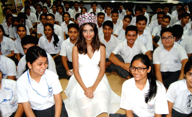 FBB Femina Miss India 2016 Priyadarshini Chatterjee with students of Maria Public School posing for photo during the visit to her Alma mater in Guwahati on Aug 8, 2016. - Priyadarshini Chatterjee