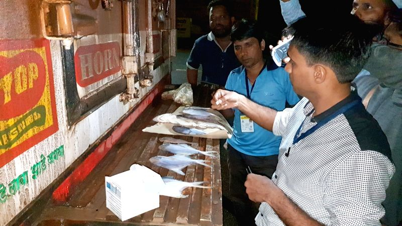FDA officials check the sample of the fish being imported from Maharashtra at Patradevi Check Post (Goa-Maharashtra) on Aug 4, 2018. Import of fishing resumed after the Government ban of ...