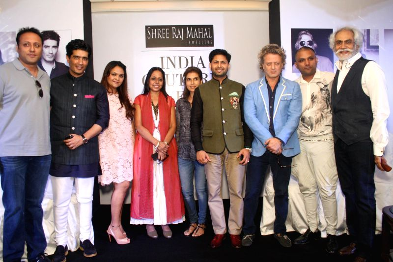 FDCI President Sunil Sethi with designers Rohit Bal, Manish Malhotra and others during the preview of upcoming India Couture Week 2014 in New Delhi on June 19, 2014. - Manish Malhotra