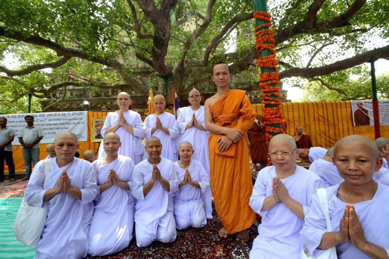 Female members of Thailand army get ordinated as Buddhist nun at Bodhgaya Mahabodhi temple on June 28, 2014.