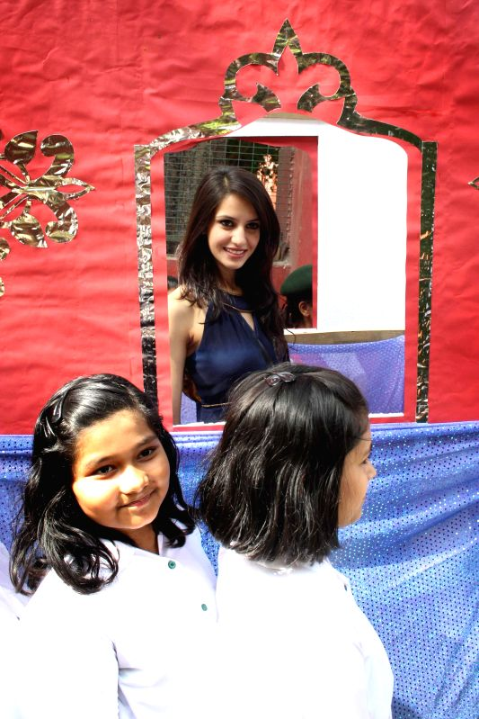 Femina Miss India 2014 Koyal Rana at St. Thomas Girls School from where she had passed out in New Delhi on April 26,2014.
