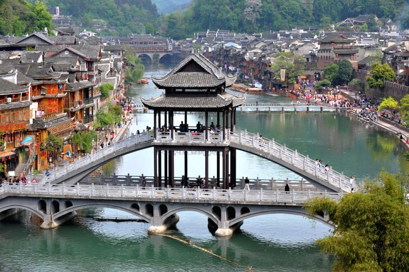 Photo taken on April 22, 2014 shows the scenery at the scenic spot of the  Phoenix (Fenghuang) ancient city, central China's Hunan Province. The Phoenix city, ...