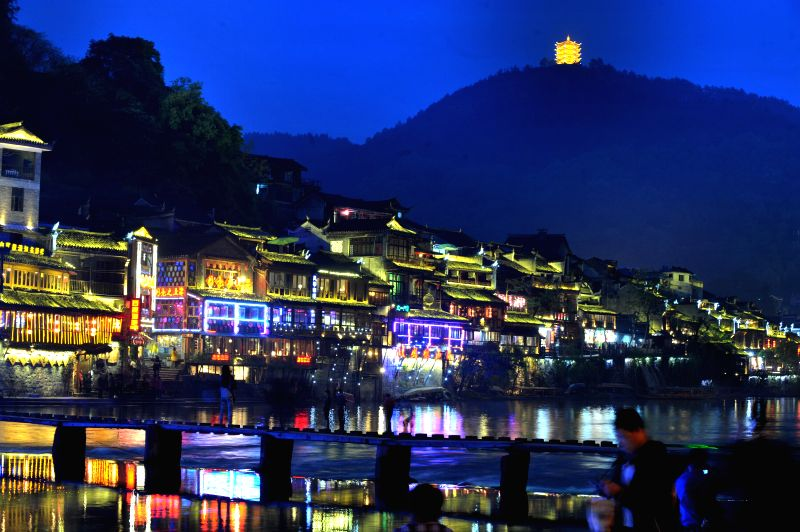 Photo taken on April 23, 2014 shows the night view of the ancient town of Fenghuang, central China's Hunan Province.