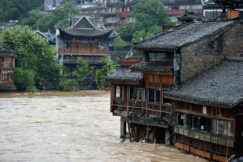 The tourist destination of Fenghuang is flooded in central China's Hunan Province, July 16, 2014. Hunan Province has been ravaged by heavy rains since early ...