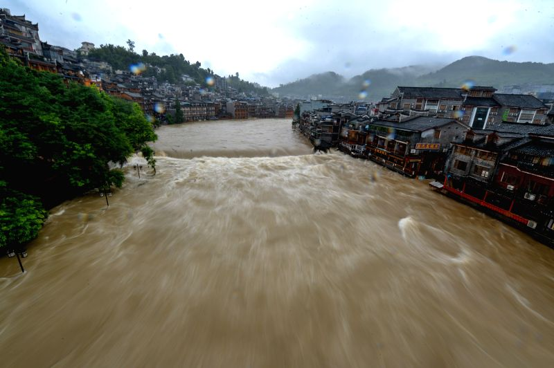 Water level of Tuojiang River surges due to rainfall in the tourist destination of Fenghuang, central China's Hunan Province, July 16, 2014. Hunan Province has ...