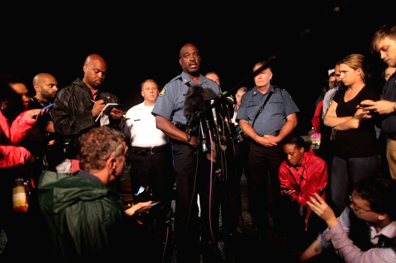 FERGUSON,Missouri State Police Highway Captain Ron Johnson speaks to reporters in Ferguson, Missouri, the United States Aug. 17, 2014. A man was shot and was critically