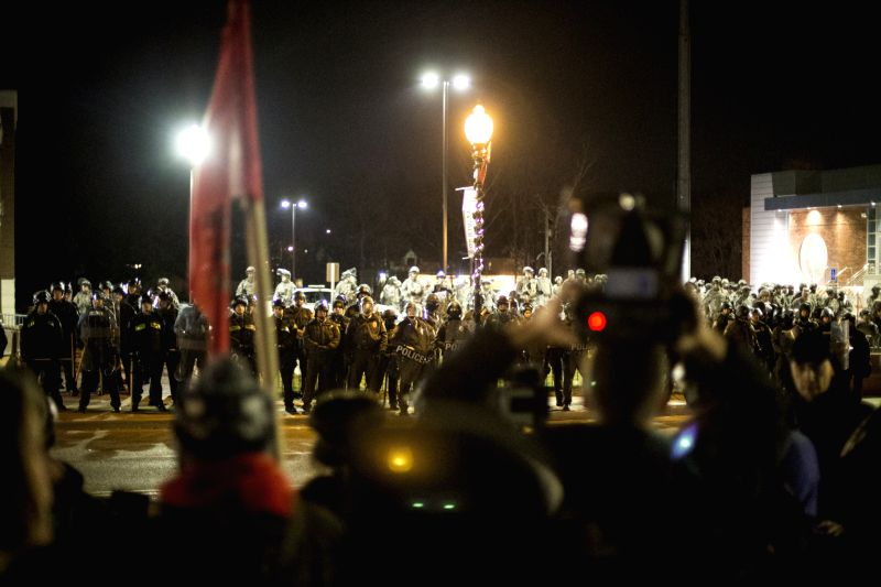 Ferguson (United States): Protesters use a loud speaker to chant and communicate their views toward National Guard and Police Forces in Ferguson, Missouri, the United States, on Nov. 28, 2014. Police