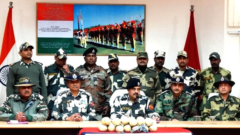 BSF officials display 13 kg heroin and weapons that were seized near Indo-Pakistan border  in Ferozepur of Punjab on Jan 23, 2015.
