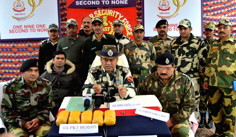 BSF officials display 5 kg heroin seized near the Indo-Pak border outpost Rattoke in Ferozepur of Punjab on Jan 3, 2015.