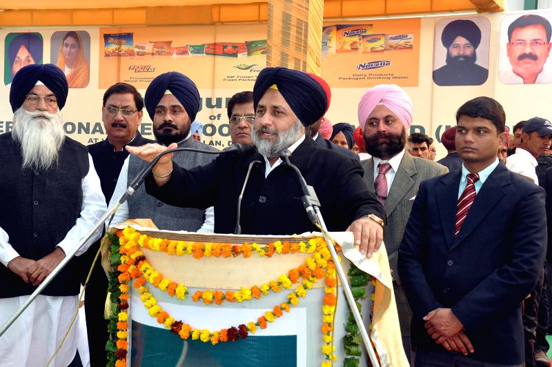 Punjab Deputy CM Sukhbir Singh Badal addresses during the inaugration of mega international food park in Dabwala Kalan, Fazilka, Ferozepur District, Punjab on Dec. 13, 2014.