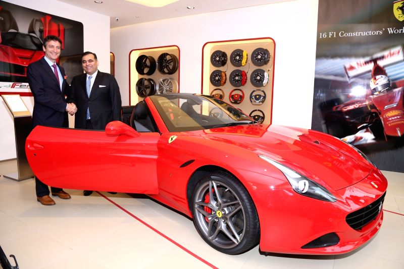Ferrari SpA senior Vice-President Commercial and Marketing Enrico Galliera and Select Cars Pvt. Ltd. Director Yadur Kapur during the launch of Ferrari`s showroom in New Delhi on Nov 30, ...