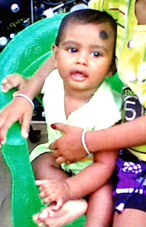 File photo of the two years old baby boy named Akhirul Islam who felt down in a water boring pipe in Guwahati on May 3, 2014.