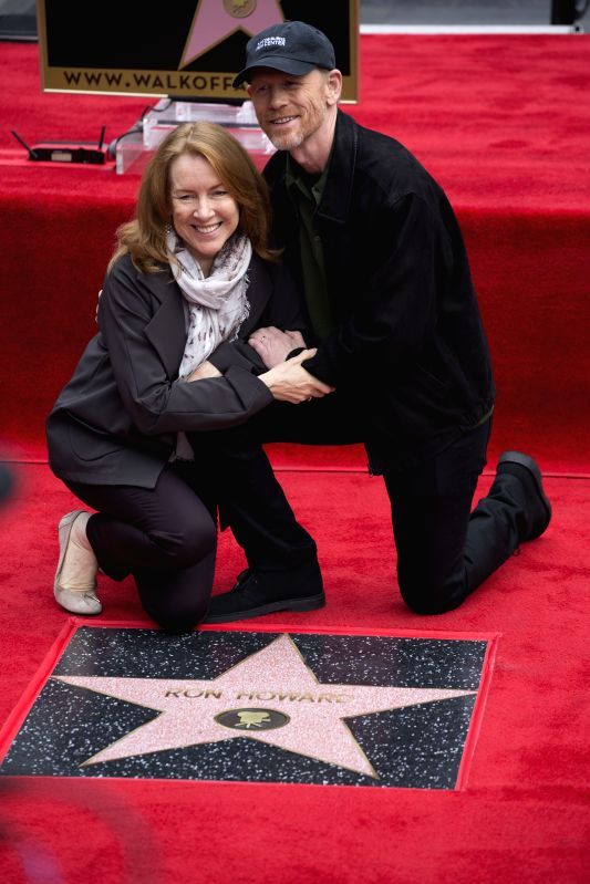 Film director Ron Howard(R) poses for photos with his wife in front of his star on the Hollywood Walk of Fame in Hollywood, California, Dec. 10, 2015. Howard ...