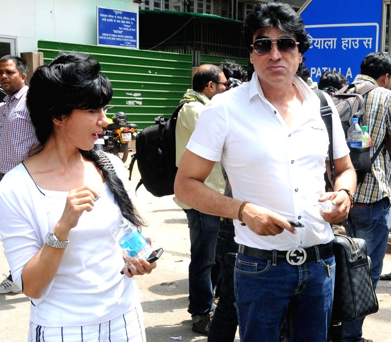 Film producer Karim Morani one of the accused in 2G spectrum allocation case and his wife arrive at Patiala House Court in New Delhi on May 5, 2014.