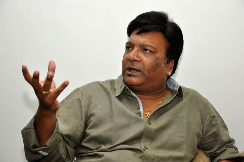 Film producer Kona Venkat talks to press.