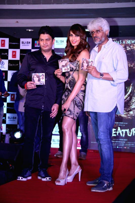 Filmmaker Bhushan Kumar, actor Bipasha Basu and filmmaker Vikram Bhatt during the music launch of film Creature 3D in Mumbai, on August 12, 2014. - Bhushan Kumar and Bipasha Basu