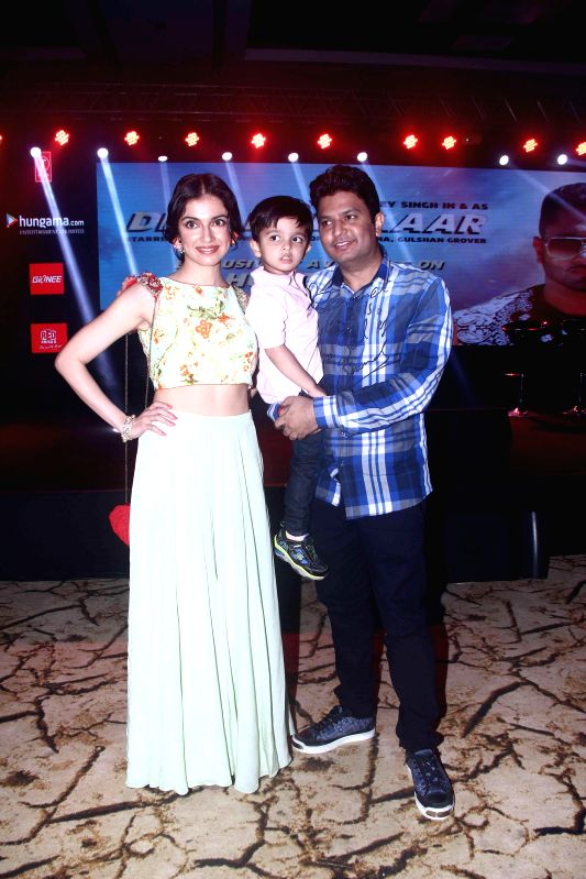 Filmmaker Bhushan Kumar with his wife Divya Khosla and son during the launch of new music album Desi Kalakaar in Mumbai on Aug. 26, 2014. - Bhushan Kumar