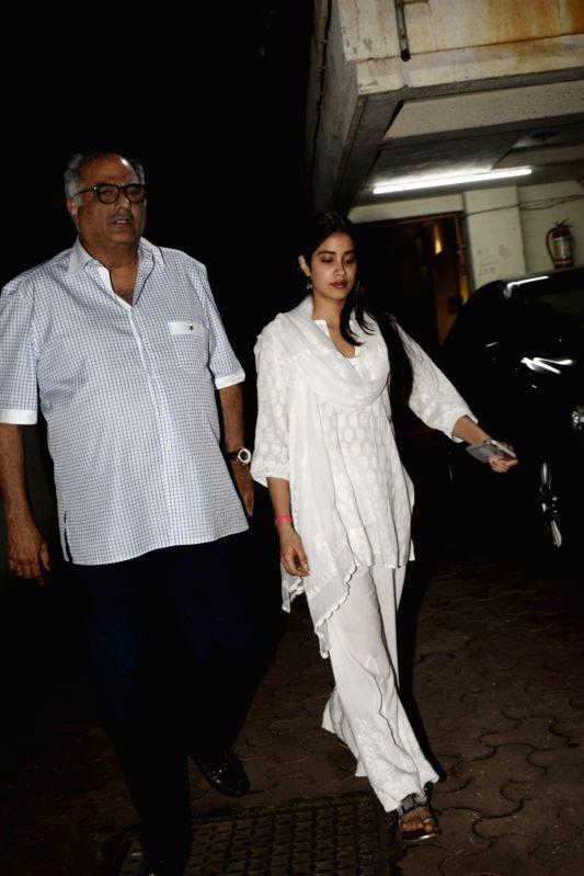 Filmmaker Boney Kapoor along with daughter Janhvi Kapoor arrive at son Arjun Kapoor's residenc, in Mumbai on Aug 11, 2018. - Boney Kapoor, Janhvi Kapoor and Arjun Kapoor