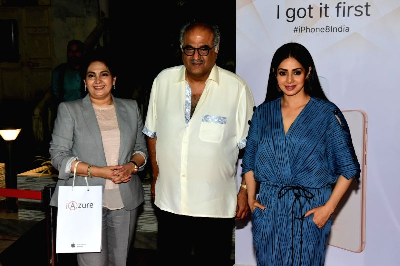 Filmmaker Boney Kapoor along with wife and actress Sridevi during the launch of iPhone 8 and iPhone 8+ at iAzure Apple Store in Mumbai on Sept 29, 2017. - Boney Kapoor